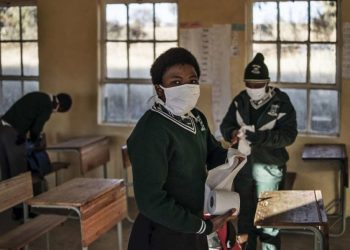 A Grade 7 student of the Sitoromo Junior Secondary School in Sterkspruit, takes some toilet paper to clean her desk on July 06, 2020. PHOTO: MARCO LONGARI / AFP