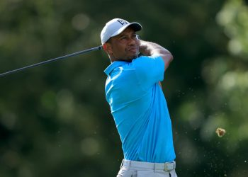 DUBLIN, OHIO – JULY 16: Tiger Woods of the United States plays his shot from the 18th tee during the first round of The Memorial Tournament on July 16, 2020 at Muirfield Village Golf Club in Dublin, Ohio. Sam Greenwood/Getty Images/AFP