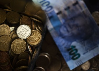 South African rand coins sit alongside a South African 100 rand banknote in this arranged photograph in Pretoria, South Africa, on Wednesday, Aug. 14, 2019. The rand ended a tumultuous week on a positive note, gaining against the dollar for a second day and heading for its first weekly advance in four as technical indicators suggested recent declines are overdone. Photographer: Waldo Swiegers/Bloomberg via Getty Images