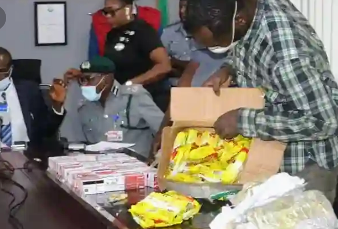 Man Arrested With 2,886 ATM Cards Concealed Inside Noddles Packs At Lagos Airport