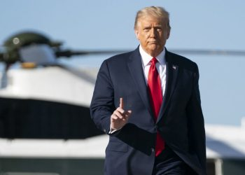 """US President Donald Trump arrives to board Air Force One at Joint Base Andrews in Maryland on October 14, 2020. – Trumps travels to Des Moines, Iowa, for a Make America Great"""" rally. (Photo by Alex Edelman / AFP)"""