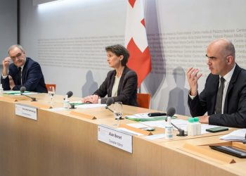 (From L) Swiss Economy Minister Guy Parmelin, Swiss President Simonetta Sommaruga and Swiss Interior Minister Alain Berset give a press conference in Bern on December 18, 2020 on new measures to try to curb a Covid-19 epidemic that continues to spread in part of the Alpine country. (Photo by Fabrice COFFRINI / AFP)