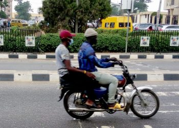 """When the authorities in Lagos State, Nigeria's commercial capital and one of the country's most populous states, banned commercial motorcycles and tricycle from major routes in Lagos city, officials said the move was aimed at securing lives and sanitising transportation in the city.  Traffic in the city is maniacal, frenzied, time-consuming, and can be outright dangerous. To reduce the number of hours spent daily in traffic, thousands of residents of the state resort to using commercial motorcycles and tricycles – okada and Keke Marwa as they are popularly called. Their sizes provide ease of navigating through hellish gridlocks.  Besides, thousands of Nigeria's army of young people are employed in the most disorganised public transport sector ferrying people on around the city's major highways and inner streets.  """"It's a lot easier for me to take a bike from here (Festac on the mainland) to Ensure Metta to get what I want to buy and come buy quickly,"""" said Ibrahim Bashir, an auto mechanic said, although he has a car of his own. """"The traffic is discouraging.""""    But state officials said in February 2020 that the motorcyclists and tricyclists, the former especially, have wreaked more havoc than could be imagined.  Consequently, the government restricted their operation in six local government areas. It said the ban will restore sanity to roads and reduce security threats. The ban encompasses Okada riders and bike-hailing companies like O'Ride, Max NG, and others.  How are Lagos roads now? It is over a year since the ban has been imposed and Okada riders still rule on major Lagos express roads, defying the government's order. In fact, they now ply the roads in Alausa Secretariat, the seat of the Lagos State Government despite signages that reads """"Okada/Motorcycles are prohibited""""."""