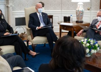 US President Joe Biden hosts a meeting alongside US Vice President Kamala Harris (L), with Senate Democrats, including Senate Majority Leader Chuck Schumer (R), as they meet about a Covid relief bill in the Oval Office of the White House in Washington, DC, February 3, 2021. (Photo by SAUL LOEB / AFP)