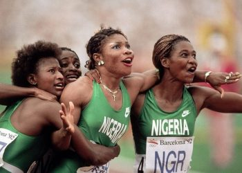 Beatrice Utondu, Faith Idehen, Christy Opara-Thompson, and Mary Onyali celebrate after placing a historic third in the final of the Women's 4x100m relay final at Estadi Olimpic de Montjuic, in Barcelona, Spain. Nigeria's women's relay team will be seeking to qualify for the Tokyo Games. Photo by Bill Frakes / Sports Illustrated.