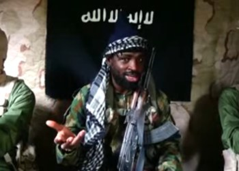 [FILE PHOTO] This file screengrab taken on May 6, 2017 from a video released by the Nigerian Islamist extremist group Boko Haram shows the leader of the Nigerian Islamist extremist group Boko Haram, Abubakar Shekau flanked by two fighters at an unidentified location. PHOTO: THE GUARDIAN / BOKO HARAM / YOUTUBE