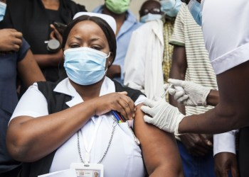 A health worker receives the COVID-19 vaccine at the University Teaching Hospital (UTH) in Lusaka, Zambia, on April 14, 2021. (Xinhua/Martin Mbangweta)