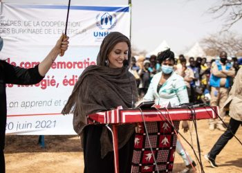 US actress Angelina Jolie, United Nations High Commissioner for Refugees (UNHCR) special envoy, gives a statement in Goudebo, a camp that welcomes more than 11,000 Malian refugees in northern Burkina Faso, on International Refugee Day on June 20, 2021. – Oscar-winning actor Angelina Jolie on Sunday visited a refugee camp in Burkina Faso sheltering thousands of Malians who have fled jihadist violence in the region. Jolie visited the camp at Goudebou, in the northeast of the landlocked west African country, as part of her role as an ambassador for the UN refugee organisation, the UNHCR. (Photo by OLYMPIA DE MAISMONT / AFP)