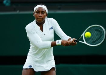 LONDON, ENGLAND - JULY 06: Coco Gauff of The United States, playing partner of Caty McNally of The United States plays a backhand in their Ladies' Doubles Third Round match against Veronika Kudermetova and Elena Vesnina of Russia during Day Eight of The Championships - Wimbledon 2021 at All England Lawn Tennis and Croquet Club on July 06, 2021 in London, England. (Photo by Mike Hewitt/Getty Images)