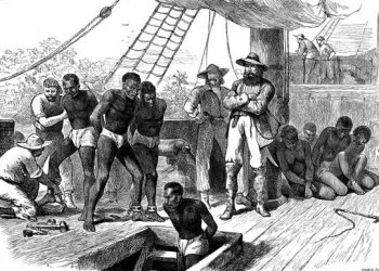 African captives being transferred to ships along the Slave Coast for the transatlantic slave trade, c. 1880. | Image: Photos.com/Getty Images
