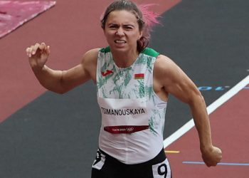 (FILES) This file photo taken on July 30, 2021 shows Belarus' Krystsina Tsimanouskaya competing in the women's 100m heats during the Tokyo 2020 Olympic Games at the Olympic Stadium in Tokyo. – Poland has granted a humanitarian visa to Krystsina Tsimanouskaya, a Belarusian Olympic athlete who claimed her team tried to force her to leave Japan, Poland's deputy foreign minister said on August 2, 2021. (Photo by Giuseppe CACACE / AFP)