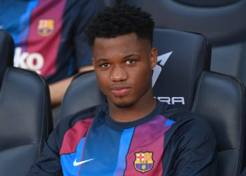 Barcelona's Spanish midfielder Ansu Fati sits on the bench during the Spanish League football match between FC Barcelona and Levante UD at the Camp Nou stadium in Barcelona on September 26, 2021. (Photo by LLUIS GENE / AFP)
