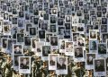 This handout picture taken and released by the Azerbaijani presidency of September 27, 2021, shows people taking part in a march through the streets of Baku to commemorate those left dead in six weeks of fighting for control of the Nagorno-Karabakh region on the first anniversary of the conflict. (Photo by Handout / Azerbaijani presidency / AFP) /