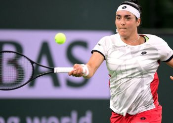 Ons Jabeur of Tunisia hits a forehand return to Paula Badosa of Spain during their semifinal match at the ATP-WTA Indian Wells tennis tournament on October 15, 2021 in Indian Wells, California. (Photo by Frederic J. BROWN / AFP)