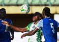 Nigeria's forward Victor Osimhen is challenged during the 2022 Qatar World Cup African qualifiers group 3 football match between Nigeria and Central Africa Republic. He was on target on Sunday against the CAR in Douala.