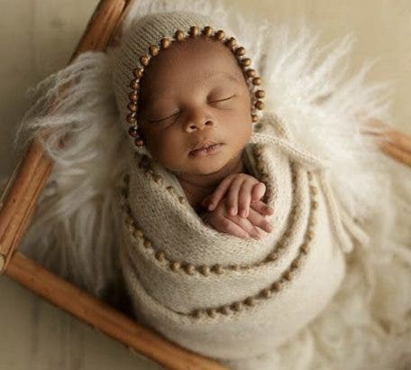 BBNaija star, Mike Edwards and wife, Perri unveil son's face in adorable family photos