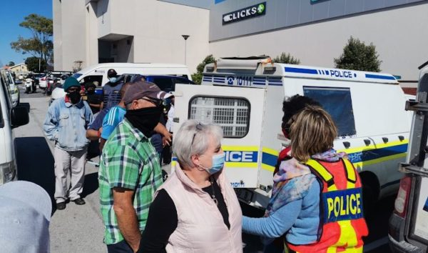 WATCH: Shopper threatens protesters outside Clicks with gun