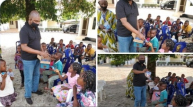 Nigerians drag presidential aspirant, Moghalu for publicising distribution of biscuits to children