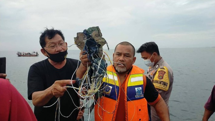 More photos of missing Indonesian passenger jet with 62 people on board surface online