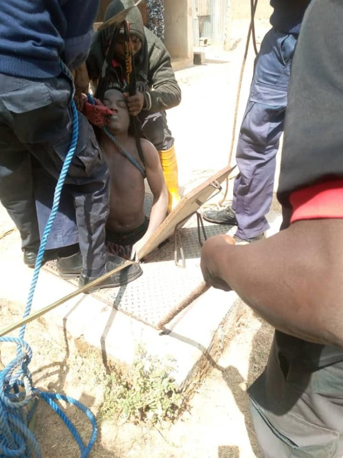 PHOTOS: Young man dies in Jos after he jumped from storey building and hid inside well to evade EFCC arrest