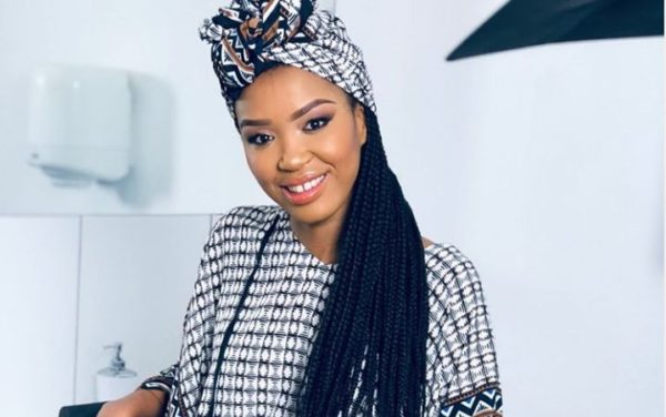 Check out Berita's beautiful headwrap game (Video)