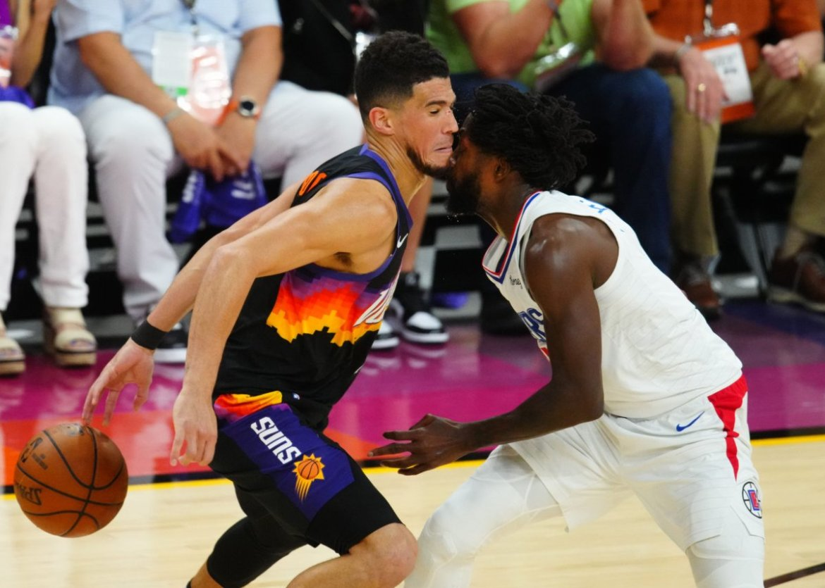 Phoenix Suns' Devin Booker and Patrick Beverley