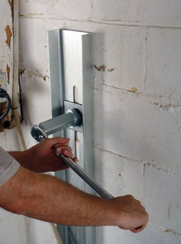 Mounting a foundation wall channel anchor in Madison.