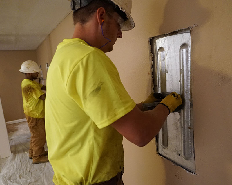 Mounting a foundation wall plate for an earth anchor installation