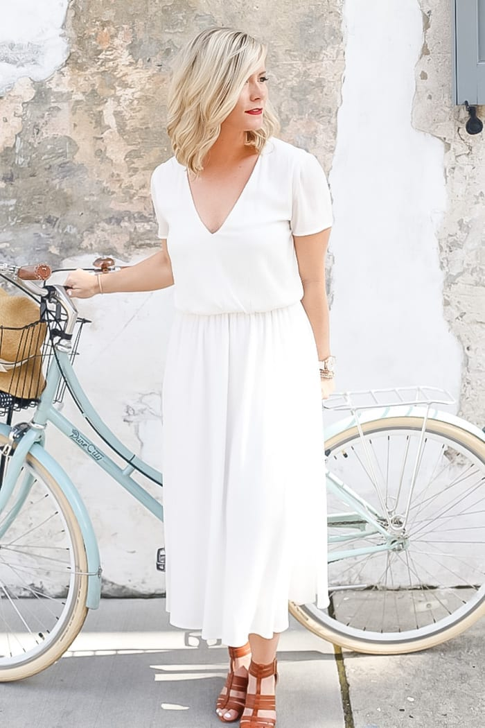 Blogger from Afternoon Espresso, Ashley Pletcher wears a Wayf white dress designed by Wayf to explore Charleston
