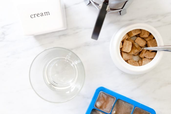 Blogger, Ashley Pletcher uses fresh vanilla, coffee ice cubes, and fresh lavender to create a Fresh Vanilla Iced Lavender Coffee Recipe.