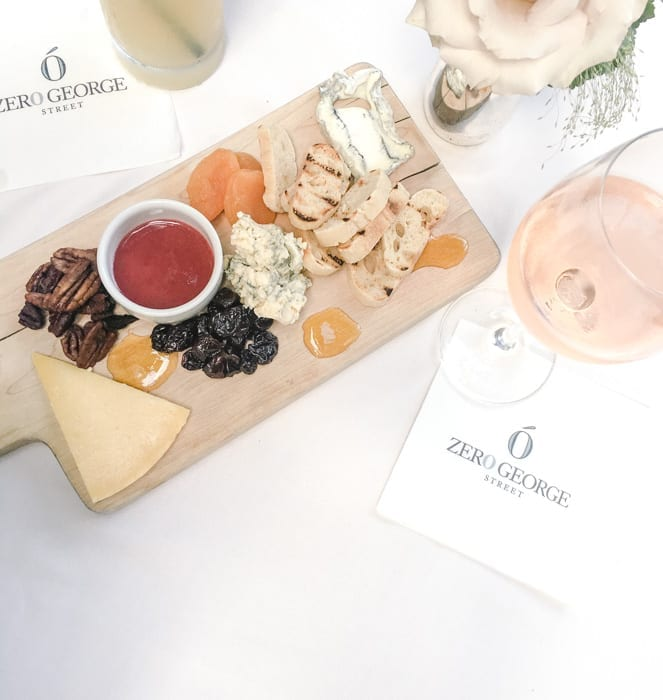 Zero George, a boutique hotel in Charleston, SC included a beautiful display of wine and cheese for happy hour each night for guests.