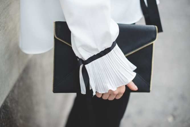 Blogger Ashley Pletcher is loving the ruffle and bell sleeve details on this Asos blouse paired with her Rebecca Minkoff envelop clutch!
