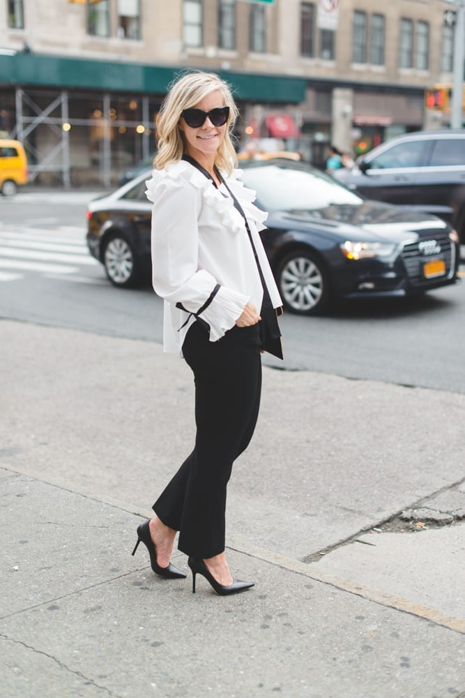 Blogger Ashley Pletcher enjoying NYC for NYFW wearing an Asos ruffle top with Express pants and Jimmy Choo Pumps!