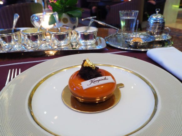 """Kempinski Mondial Cake"" (pistachio, white tea, chocolate mousse, crispy almond pralin, pineapple & cherry juice)"
