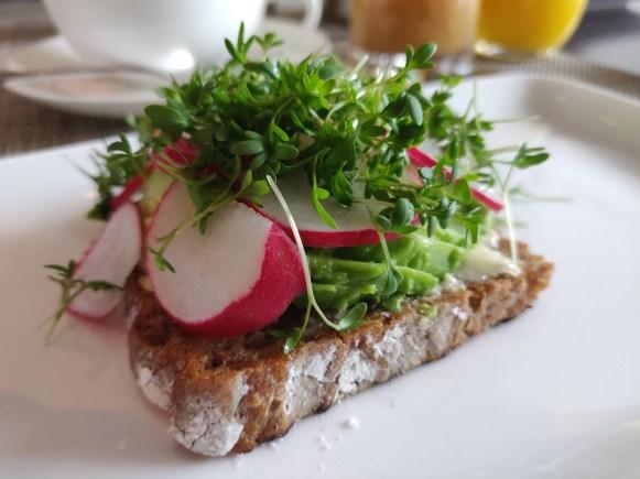 Rye bread topped with avocado, radish & cress