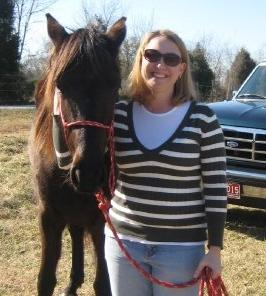 Leah Hinds, Assistant Director of the Charleston Conference, and her two year old Tennessee Walking Horse Rosie.