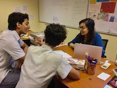 Haifa Badi-Uz-Zaman works with students at the Academy