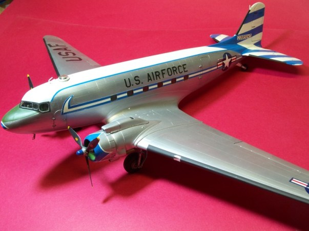 """This is the 1/48 Monogram C-47. The scheme was found in Sq. Sig. Fighting Colors book series """"USAF in Europe, vol.2"""". This was the squadron hack in '53-'54. All the striping is painted and the rest of the markings are from the spares box. A serendipitous discovery today was that I'd never been able to add the group """"Flying Tiger"""" artwork for the nose, but the CE decal sheet had extras so now I can add the final touches to this model!"""