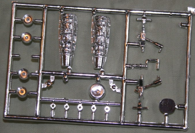 There's also a sprue of chrome-plated parts. A you can see the tops of the engines, the landing gear legs, the wheel hubs and other bits are plated: