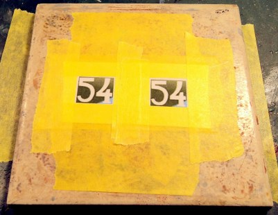 I then securely tape down the print out, which is essentially my cutting guide.