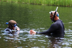 Seth gets some snorkeling training from experienced diver and Northwest Passage counselor Peter Ducos, St. Croix River upstream from Danbury, WI.