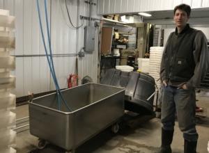 Janaki Fisher-Merritt shows off the equipment in his modern root cellar. Photo: SH