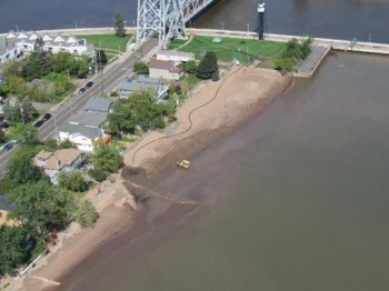 September, 2020: Pipe delivers sediment from harbor side to lake side of Park Point. Photo: USACE