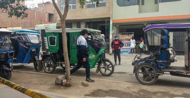 In one of Lima's poor districts–mototaxis (auto rikshaws) waiting for passengers