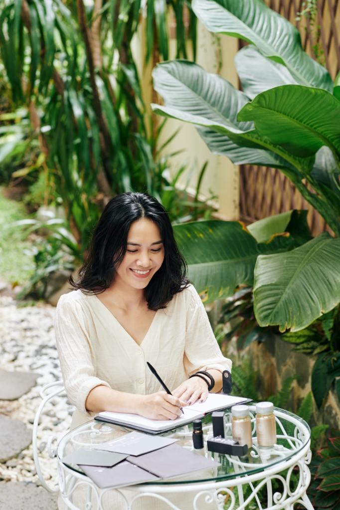 Woman writing business plan