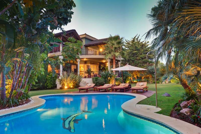 villa de montaa de Sierra Blanca con jardn tropical para
