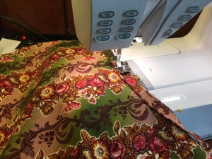 Sewing piping to waist with a zipper foot - the 1/2 seam allowance makes it easy to line up.