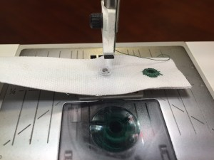 Hole made just large enough to fit around the eyelet plate on the machine.