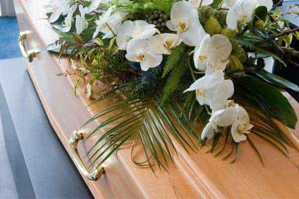 Funeral coffin and flowers