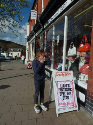 Me outside our brilliant, independent newsagent, looking at the bill board that has my headline on it!